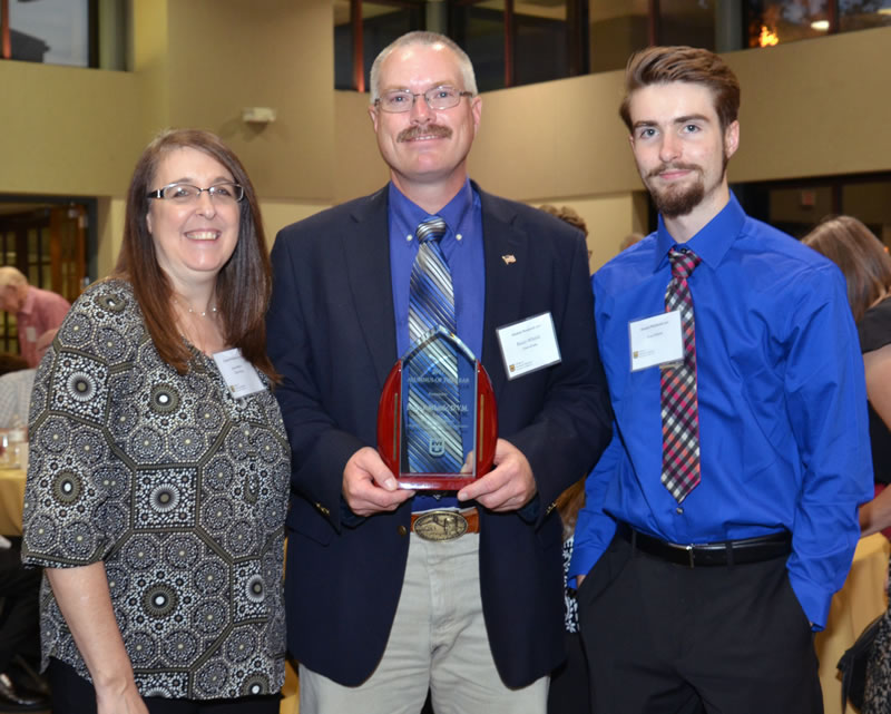 MU College of Veterinary Medicine Alumnus of the Year Bruce Whittle, DVM, is pictured with his wife, Gayla Whittle, DVM, and son Wyatt.